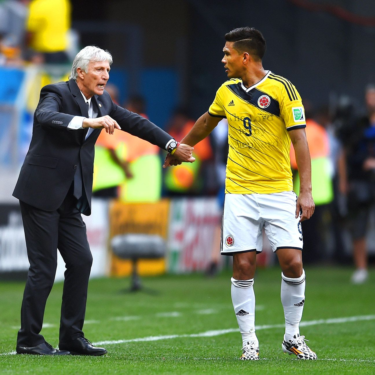 Head coach Jose Pekerman, with striker Teo Gutierrez, has inspired Colombia to two straight wins to open the World Cup.
