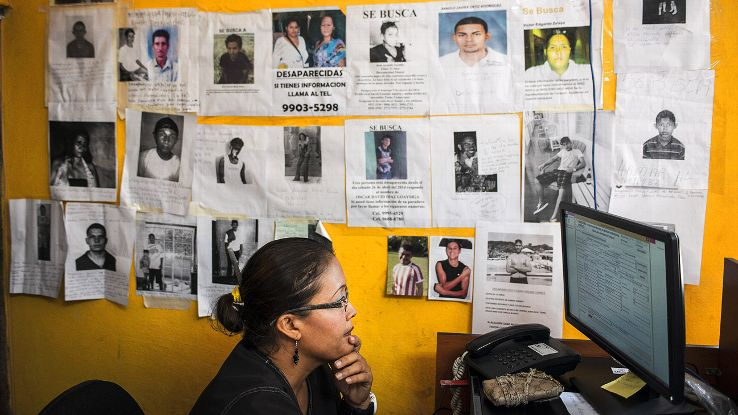 Lesvi Torres, an employee at the San Pedro Sula morgue, looks for data as the list of missing people continues to grow in the town.