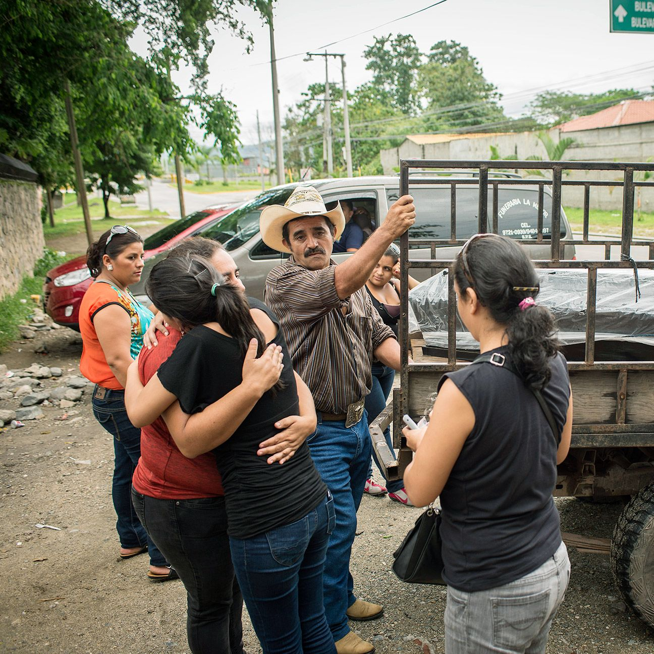 Family and friends of Marco Antonio Rosales pick up his body at the San Pedro Sula morgue.