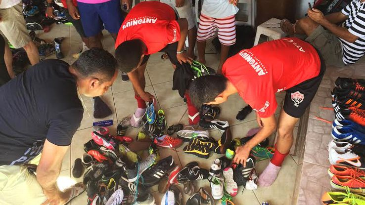Players at the Sao Marcos clubhouse sort through donations looking for a pair of new boots in which to impress.