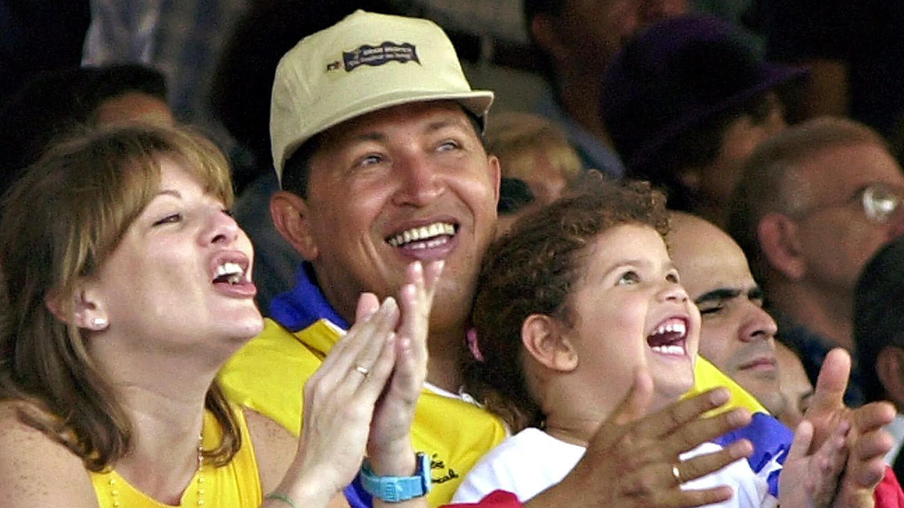 The late Venezuelan president Hugo Chavez in 2001 with daughter Rosi and wife Marisabel.