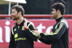 Xabi Alonso, left, and Diego Costa managed to pass time on the bench during Spain's World Cup finale.