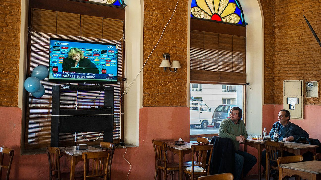 The scene inside Bar Tasende, a favorite local café for journalists and businessmen, as the Suarez ban was announced.