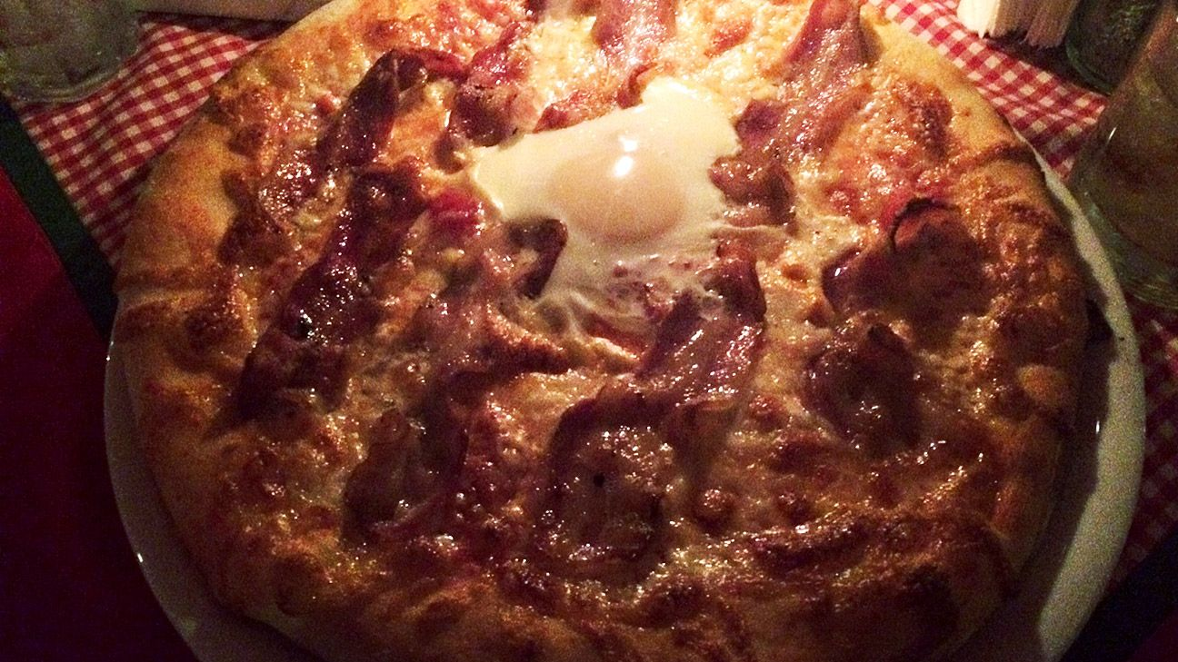The pizza at Tiramisu is American-style and comes with an egg on top.