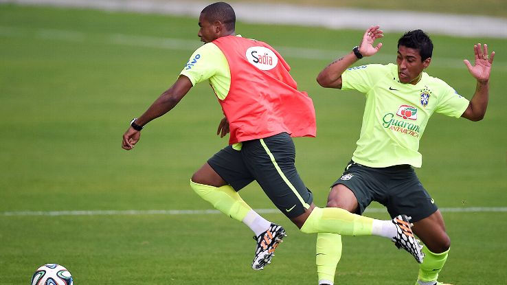 Paulinho, right, and Fernandinho have largely struggled in Brazil's midfield during the World Cup.