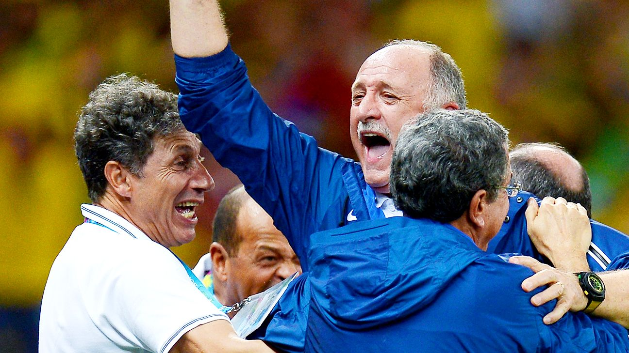 Head coach Luiz Felipe Scolari, center, has Brazil two steps away from a sixth World Cup title.