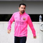 A calf injury has kept Xavi on the sidelines during Barcelona's preseason.