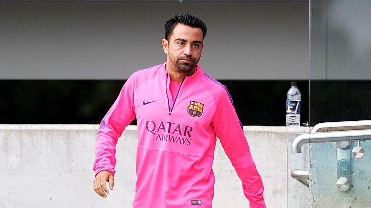 A calf injury has kept Xavi on the sidelines during Barcelona's preseason.