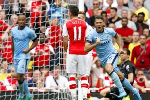Martin Demichelis rose up at the right time to snag City a late equaliser at the Emirates.