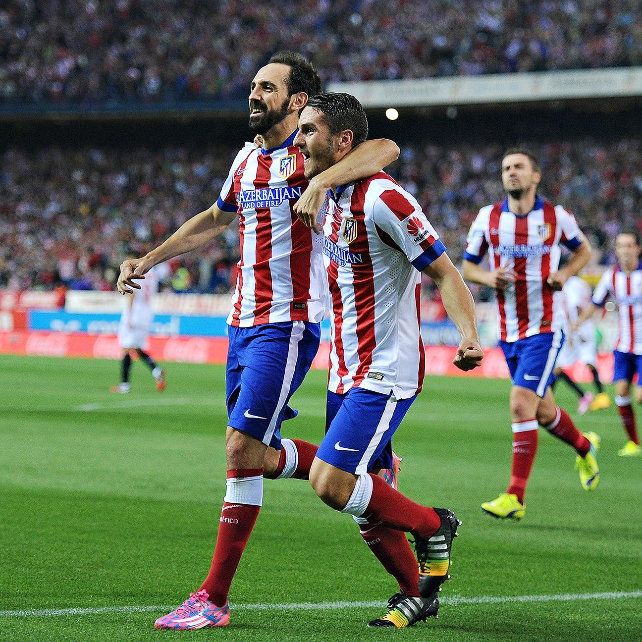 Koke, right, may be switched to a more defensive role to help protect Juanfran, left, and the rest of the Atletico back line when they meet Juventus on Thursday.