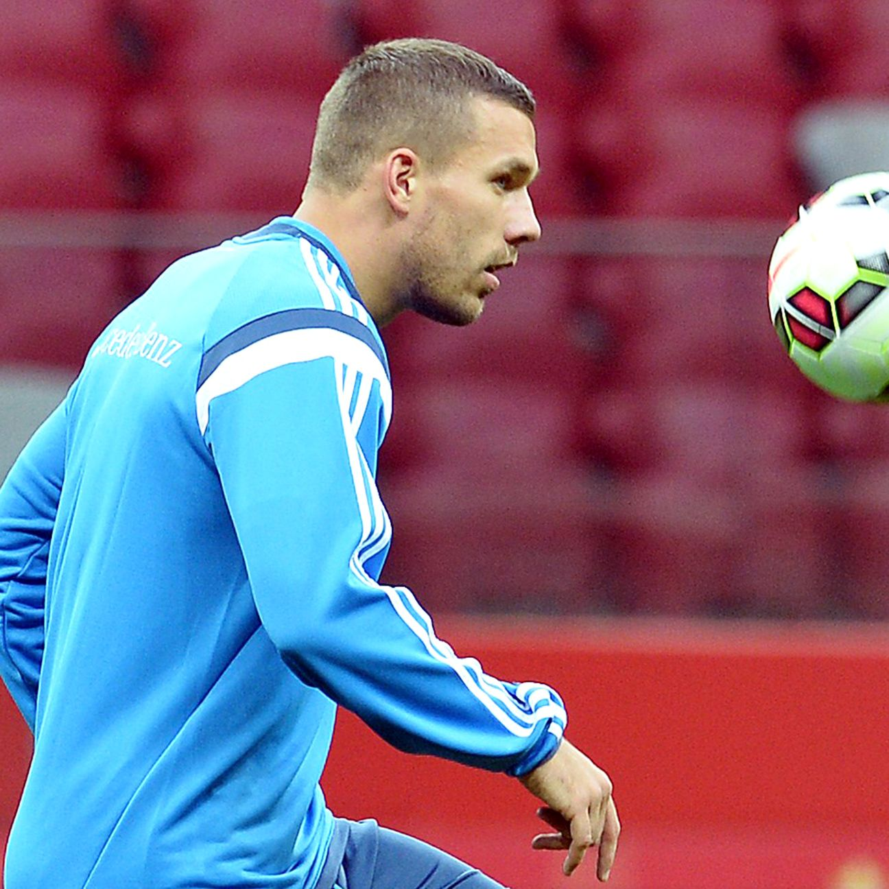 Little-used Arsenal striker Lukas Podolski hopes to remain in the German national team picture.
