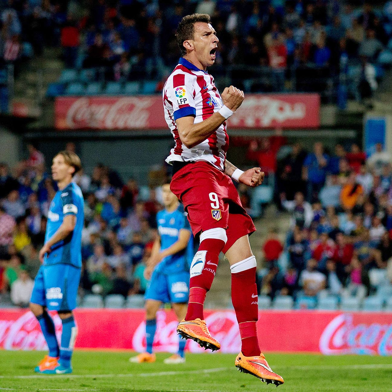 Mario Mandzukic's late first half goal was all Atletico would need to collect all three points at Getafe.