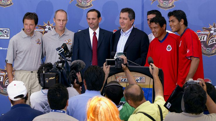 MLS Commissioner Don Garber, center left, still defends Chivas USA owner Jorge Vergara, center right, for wanting a second team in Los Angeles.