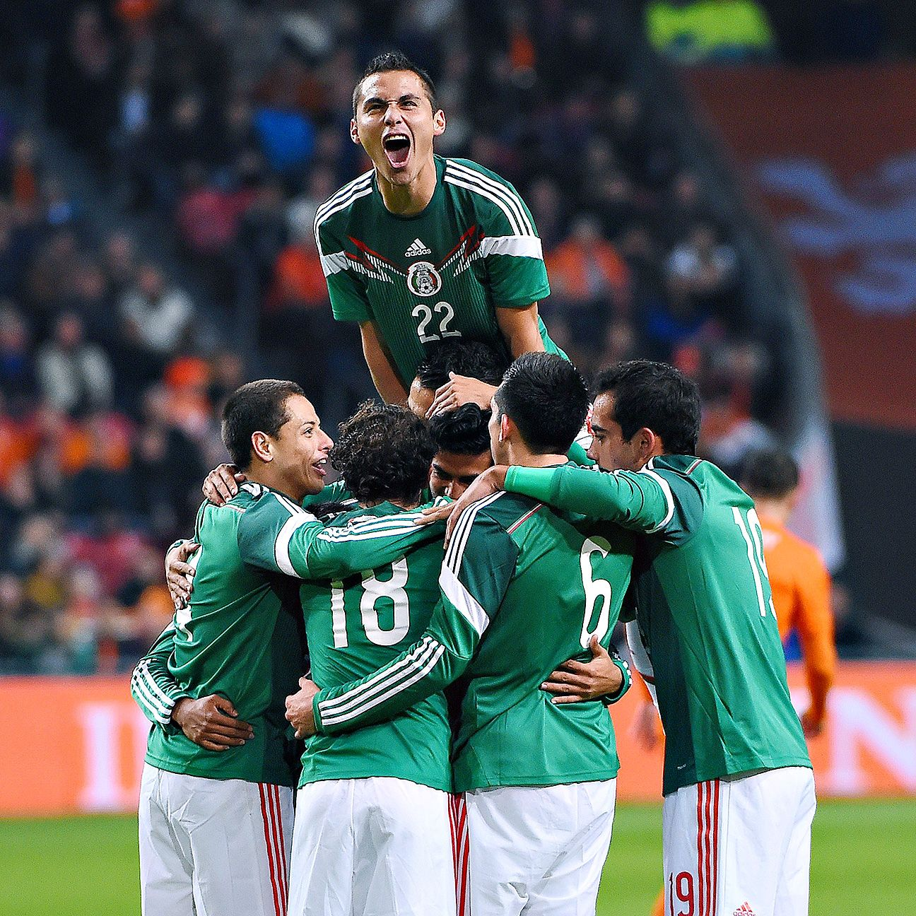 Carlos Vela was swarmed by teammates after scoring his first goal in Mexico's 3-2 triumph versus the Netherlands.