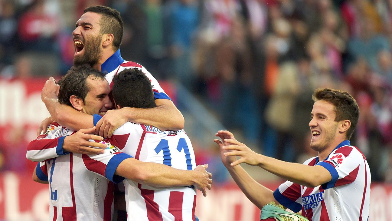 Atletico Madrid bounced back from their pre-international break defeat with a sound 3-1 win over Malaga.