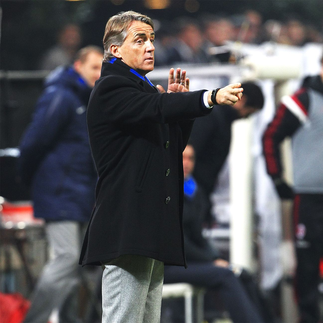 Under the watchful eye of an upbeat Roberto Mancini, Inter Milan are poised to claim victory over Parma.