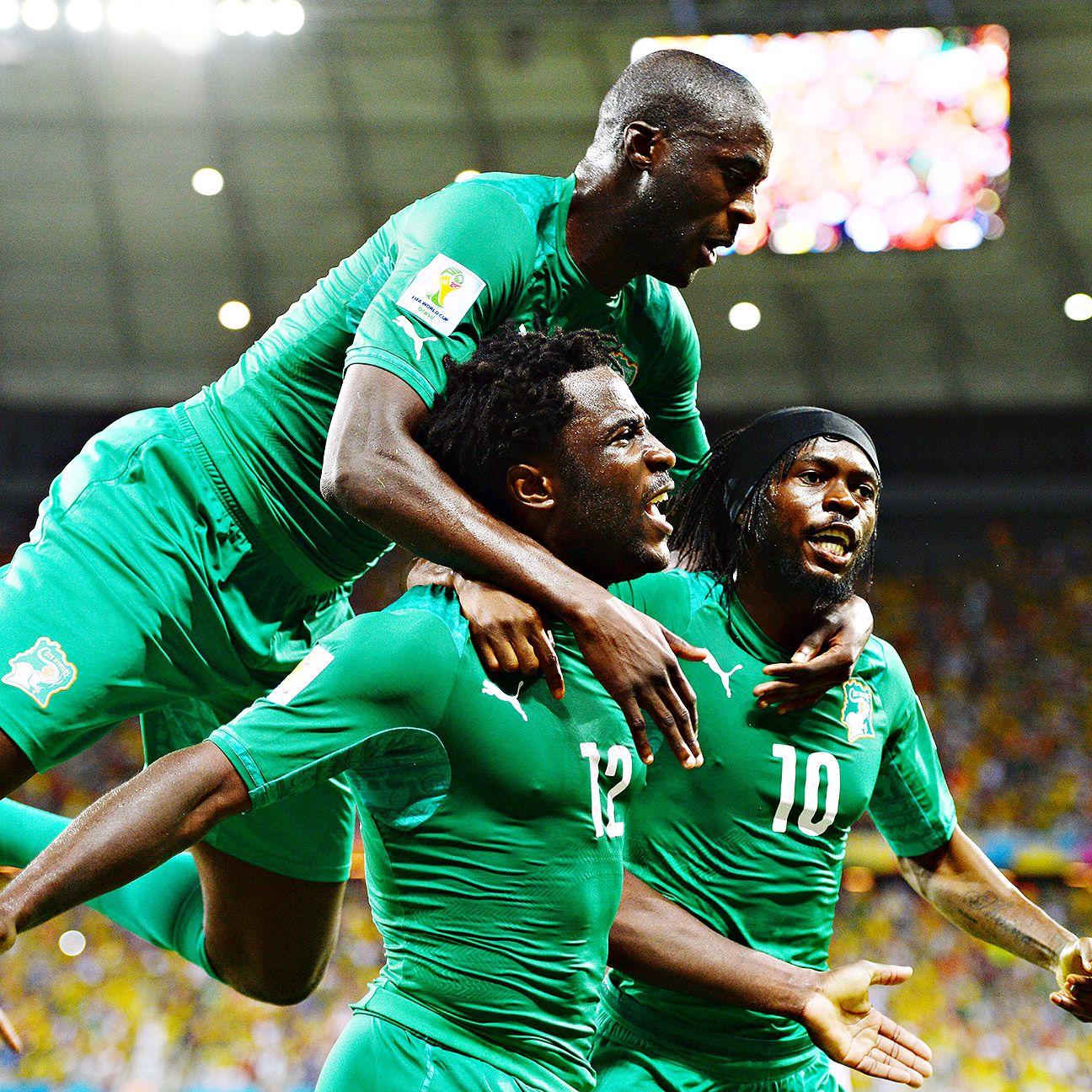 Gervinho, Yaya Toure & Wilfried Bony celebrate for the Ivory Coast