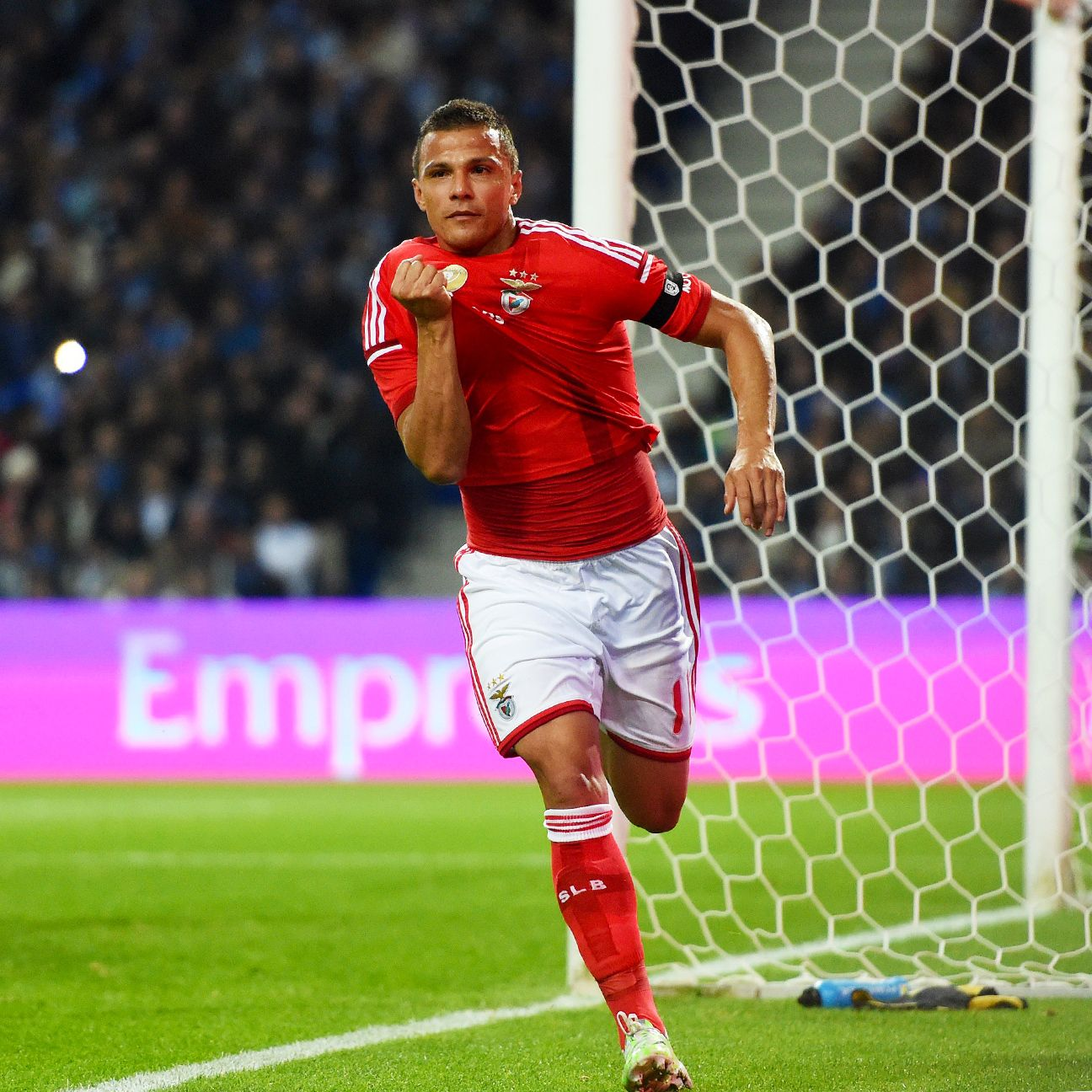 Benfica extended their lead atop the Portuguese table to six points over Porto, thanks to Lima's double.