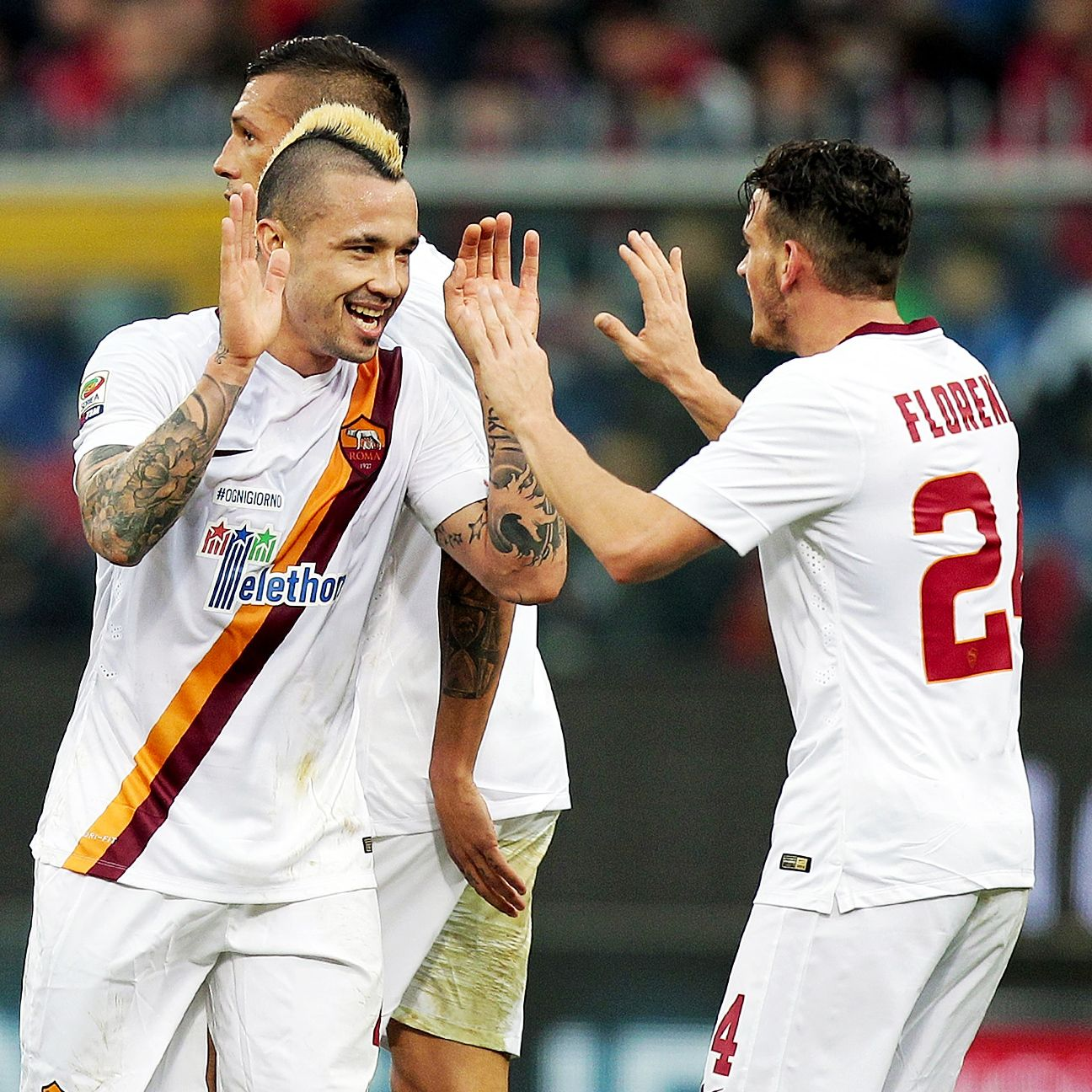 Roma shook off their Champions League disappointment to claim a crucial Serie A win at Genoa and edge closer to first place Juventus.