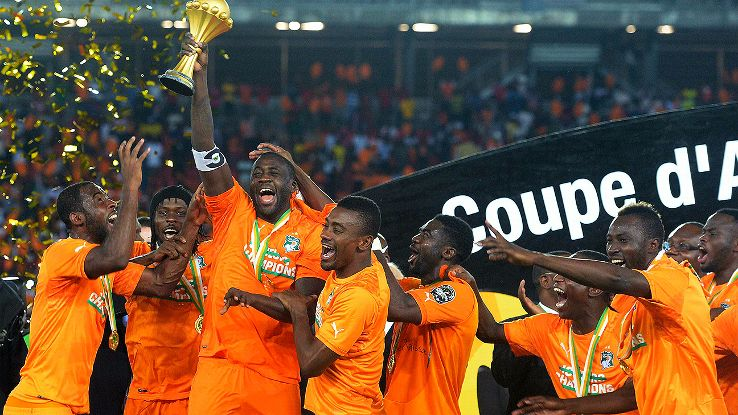 Image result for pic of yaya toure lifting the african cup of nations