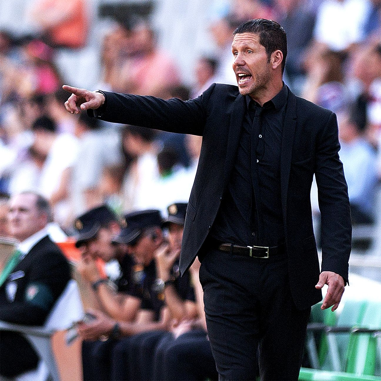 Diego Simeone's Atletico Madrid stayed in the hunt for a berth in next season's Champions League with a 2-0 win over Cordoba on Saturday.