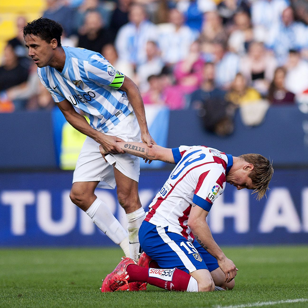 Fernando Torres missed two sitters and produced an own goal in what was a forgettable afternoon for the Atletico Madrid forward at Malaga.