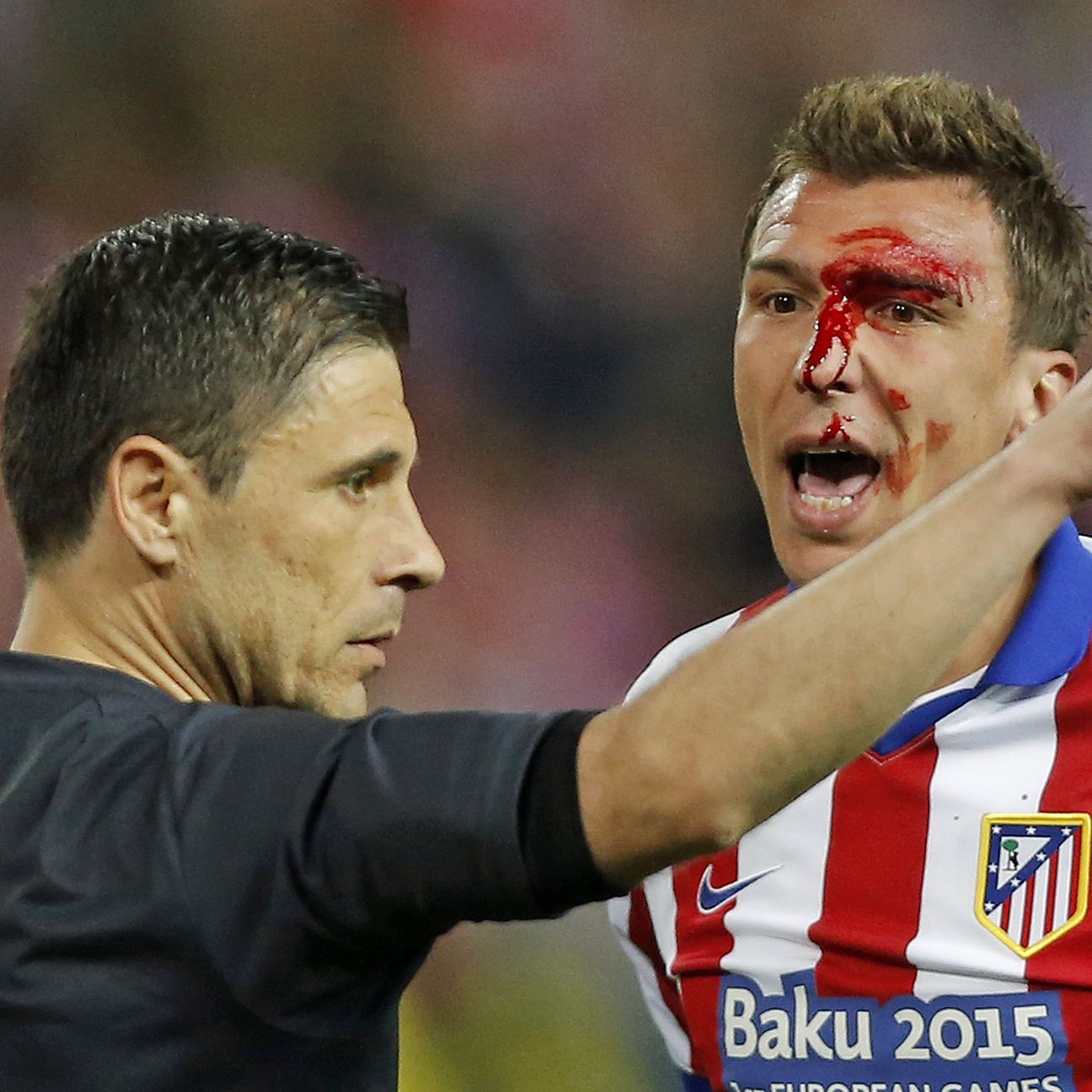 The face of Atletico striker Mario Mandzukic embodied the physical nature of Tuesday's quarterfinal first leg between Real and Atletico.