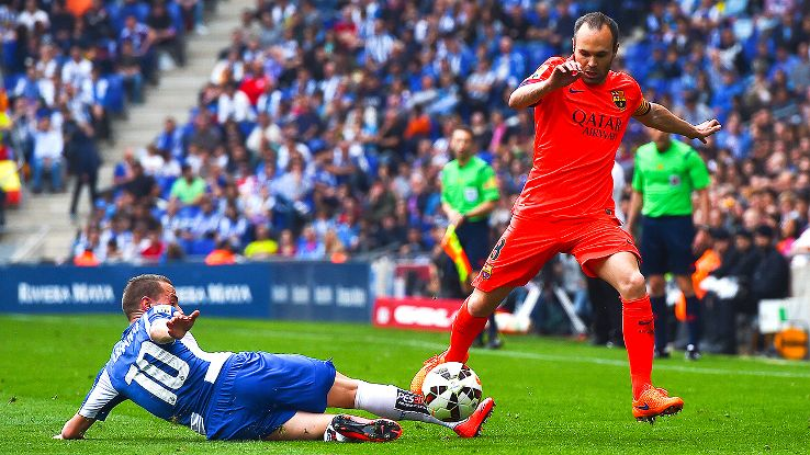 Despite many distractions, Andres Iniesta and Barcelona kept their eye on the ball and cruised to a derby win at Espanyol.