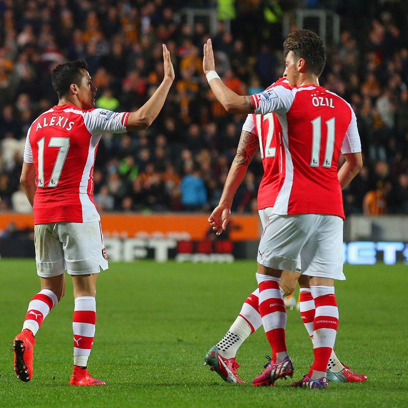 Alexis Sanchez and Mesut Ozil teamed up to terrorise Hull in the first half.