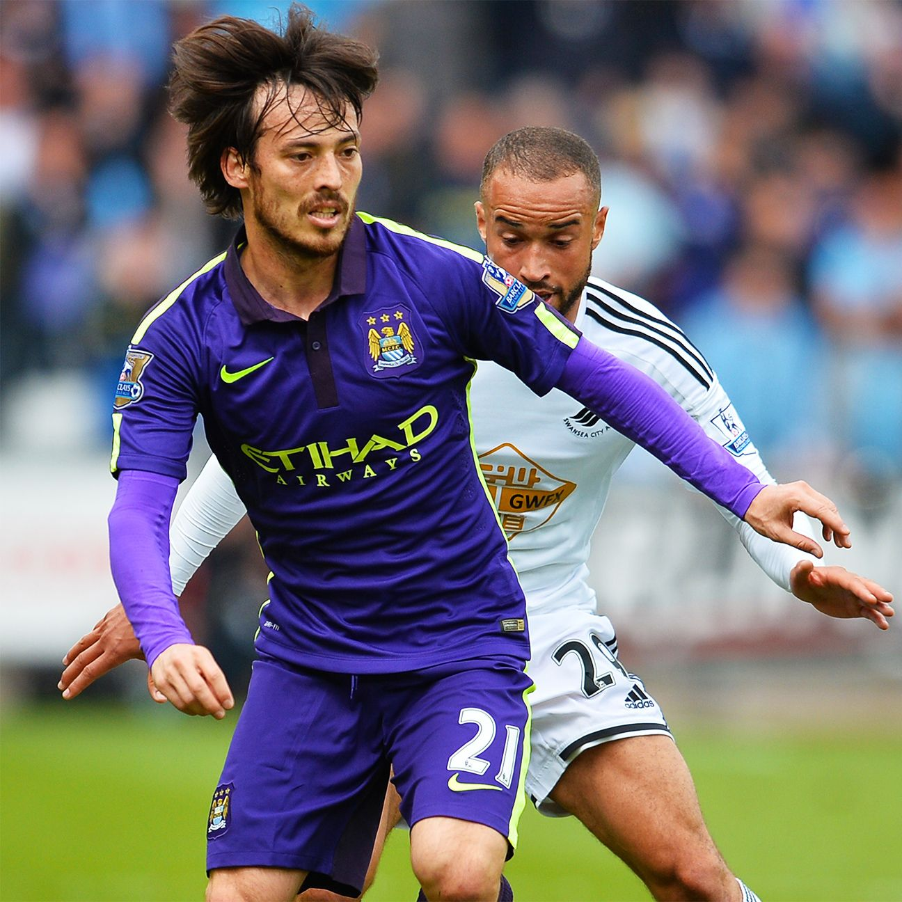 David Silva was back to his wizardry ways in midfield to help Manchester City to a 4-2 win at Swansea.