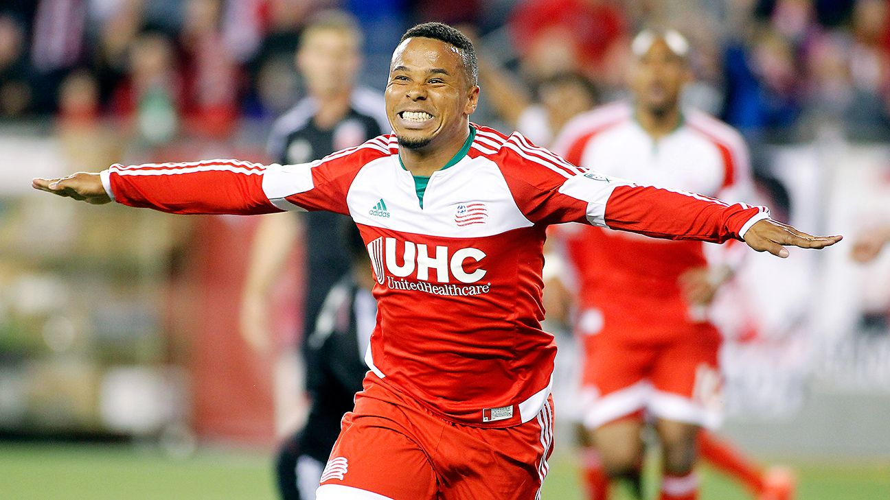 Charlie Davies celebrates after he put the Revs up 1-0 just before halftime.
