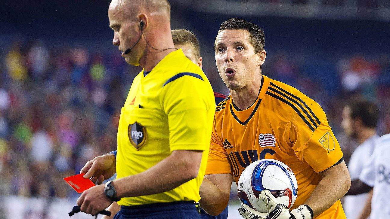 New England goalkeeper Bobby Shuttleworth pleads his case to referee Allen Chapman after his teammate Andrew Farrell was called for a red card.