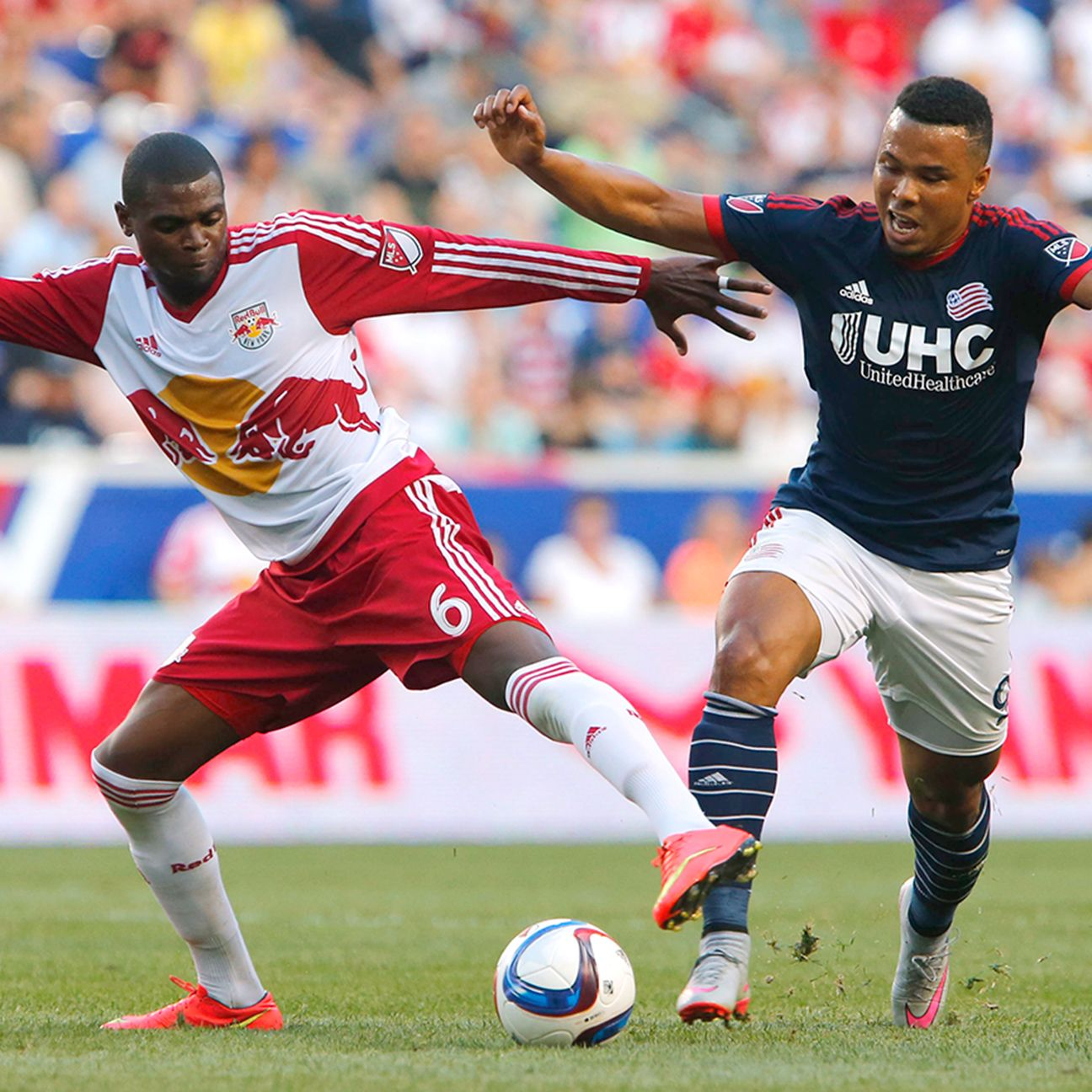 Charlie Davis tries to keep up with Anthony Wallace during the Revolution's 4-1 loss at Red Bull Arena last weekend.