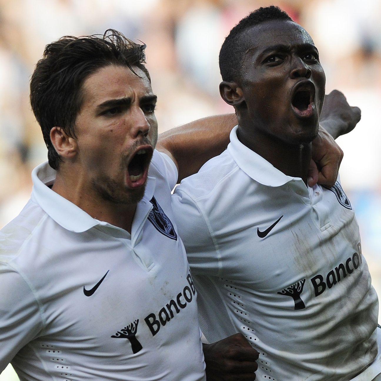 Vitoria SC's Ghanaian midfielder Bernard Mensah celebrates with teammate Tomane.