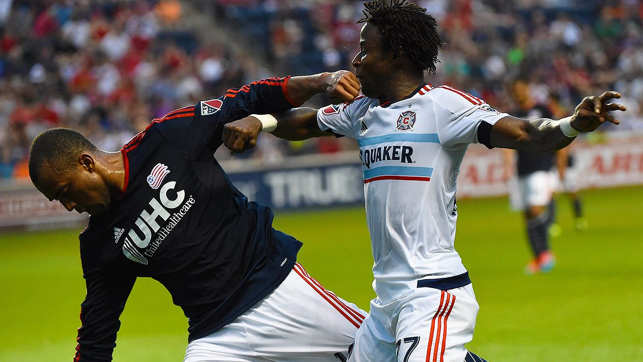 The Revs' Teal Bunbury jostles with Chicago's David Accam for a first-half loose ball.