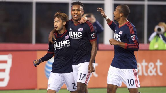Juan Agudelo, center, celebrates with teammates Lee Nguyen (24) and Teal Bunbury (10) after Agudelo's goal against the Houston Dynamo.