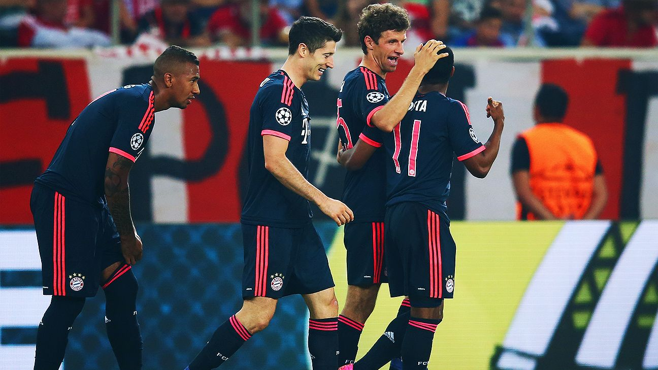 Thomas Muller, center right, continued his blistering form with a brace against Olympiakos.