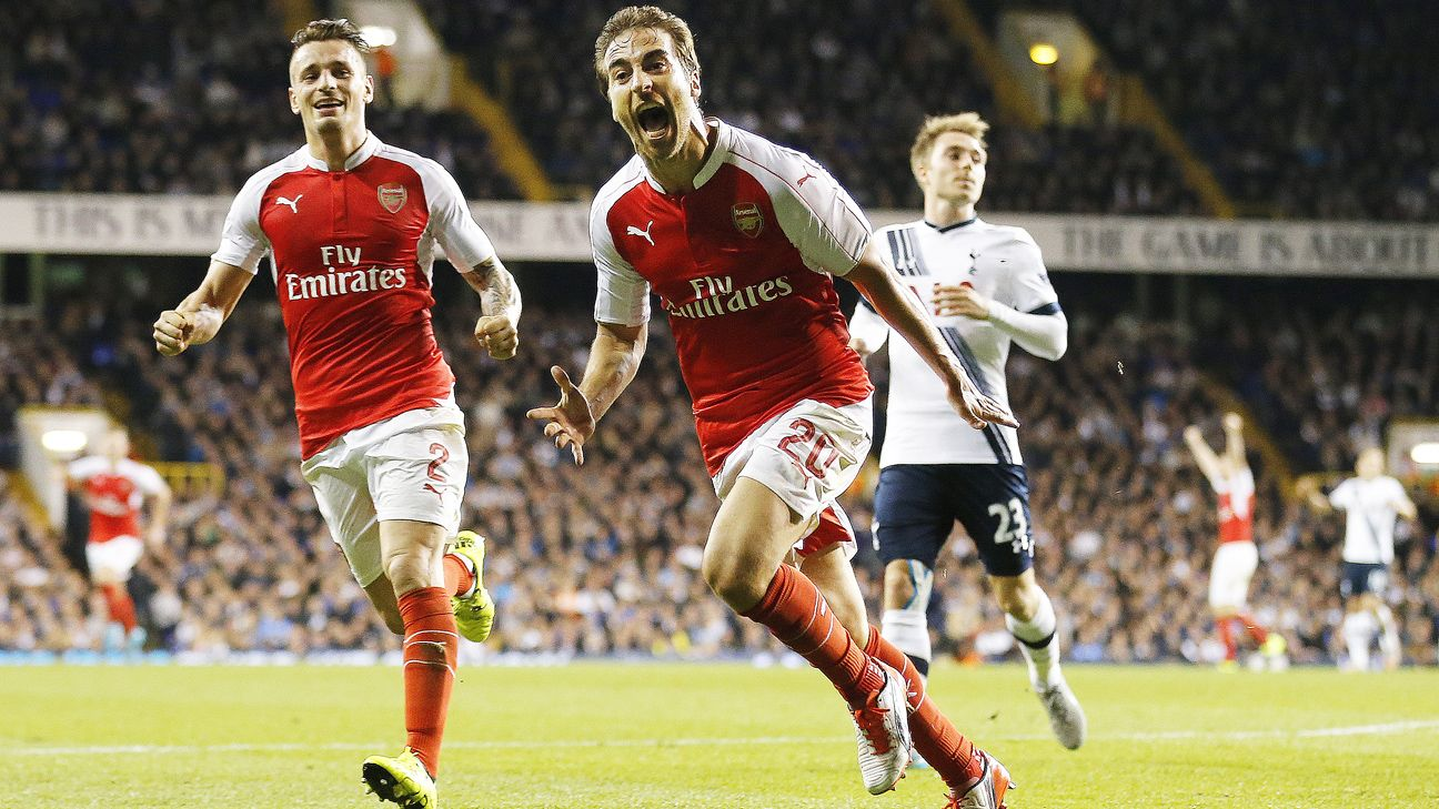 Mathieu Flamini's unlikely brace sent Arsenal to the Capital One Cup fourth round.
