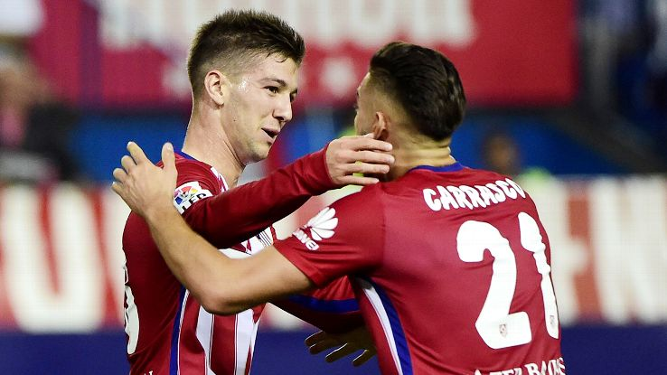 Luciano Vietto, left, struck late to earn Atletico a draw in what was his first goal for the club.