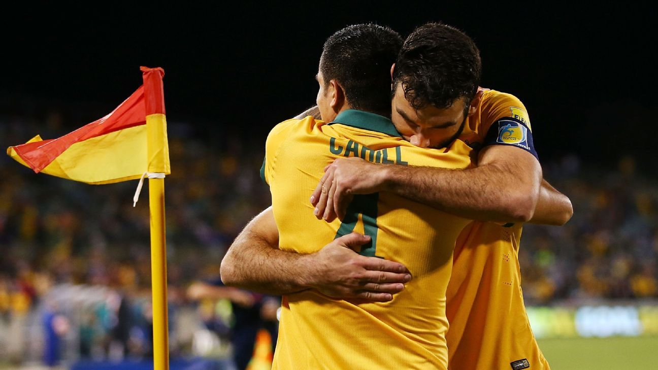 Tim Cahill and Mile Jedinak of the Socceroos embrace