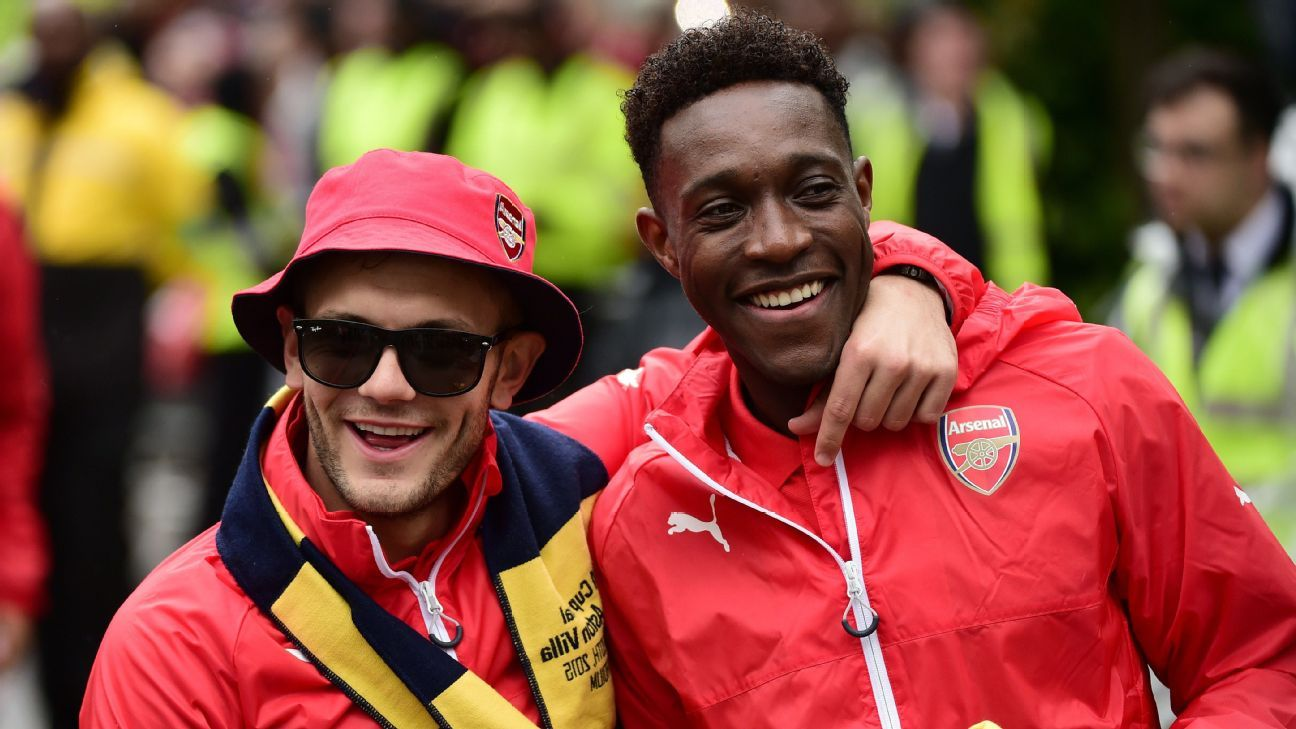Arsenal's English midfielder Jack Wilshere and Arsenal's English striker Danny Welbeck react during the Arsenal victory parade in London on May 31, 2015, following their win in the English FA Cup final football match on May 30, 2014 against Aston Villa.
