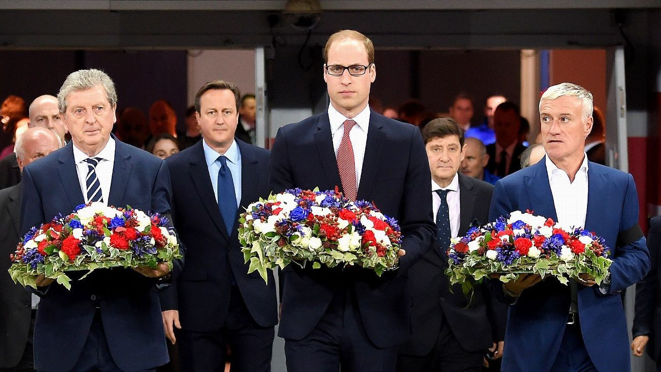 Roy Hodgson, manager of England, Prince William, The Duke of Cambridge and Didier Deschamps and Head Coach of France carry out floral tributes.