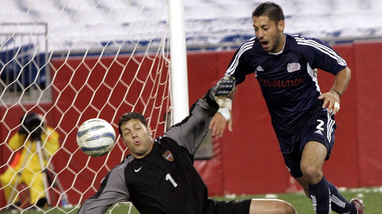 MetroStars goalie Tony Meola, left, makes a save on a shot by New England Revolution's Clint Dempsey in the 2005 MLS playoffs.