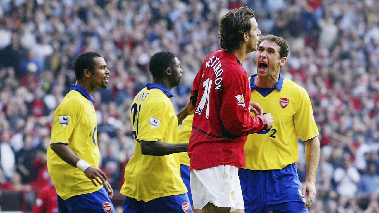 MANCHESTER, ENGLAND - SEPTEMBER 21:  Martin Keown of Arsenal shows his feelings at Ruud Van Nistelrooy of Man Utd after Van Nistelrooy missed his penalty during the FA Barclaycard Premiership match between Manchester United and Arsenal at Old Trafford on