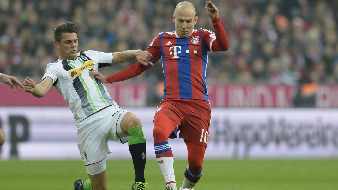 Moenchengladbach's Swiss midfielder Granit Xhaka (L) and Bayern Munich's Dutch midfielder Arjen Robben vie for the ball during the German first division Bundesliga football match FC Bayern Munich vs Borussia Moenchengladbach in Munich, southern Germany, o