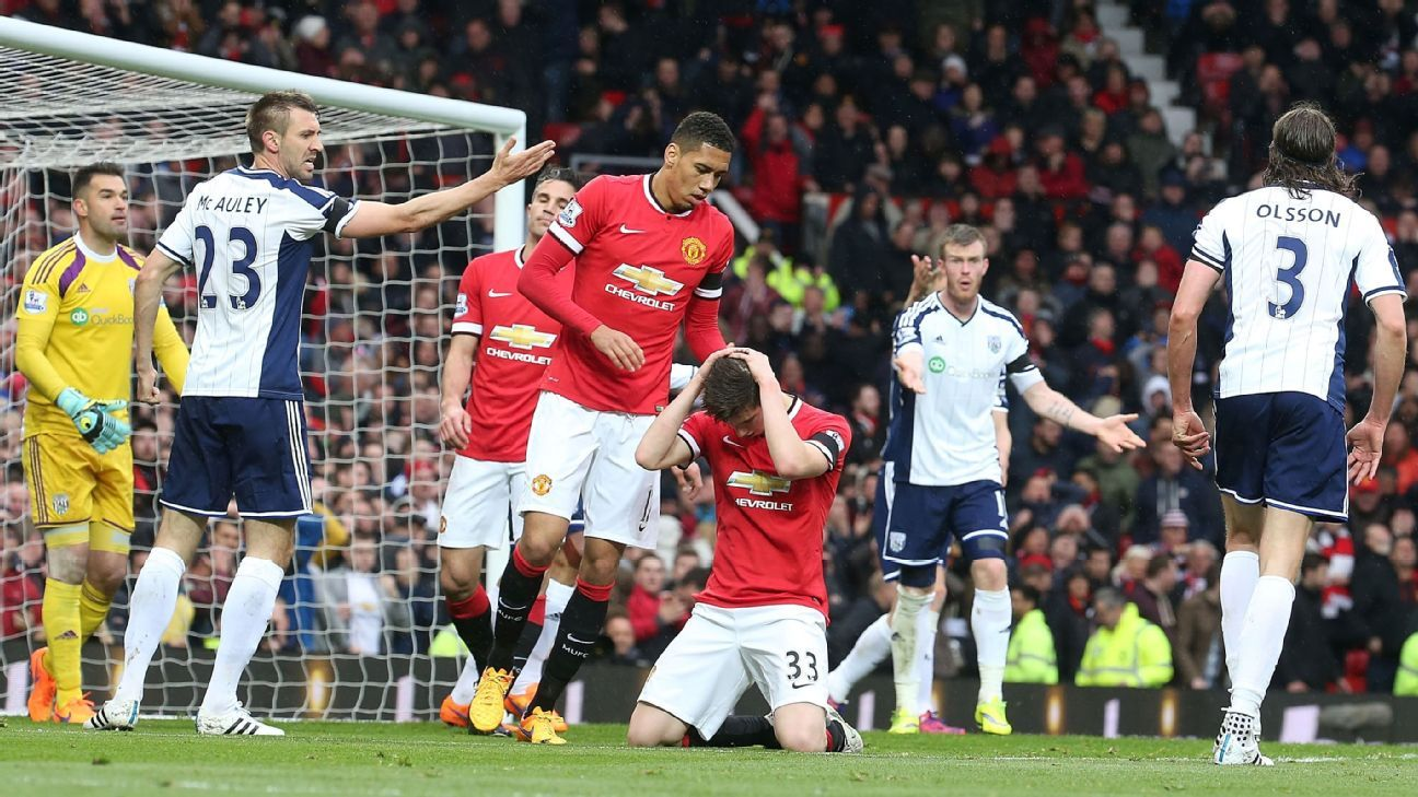 Still just 20, Paddy McNair, kneeling, could learn much from veteran centre-back Chris Smalling.