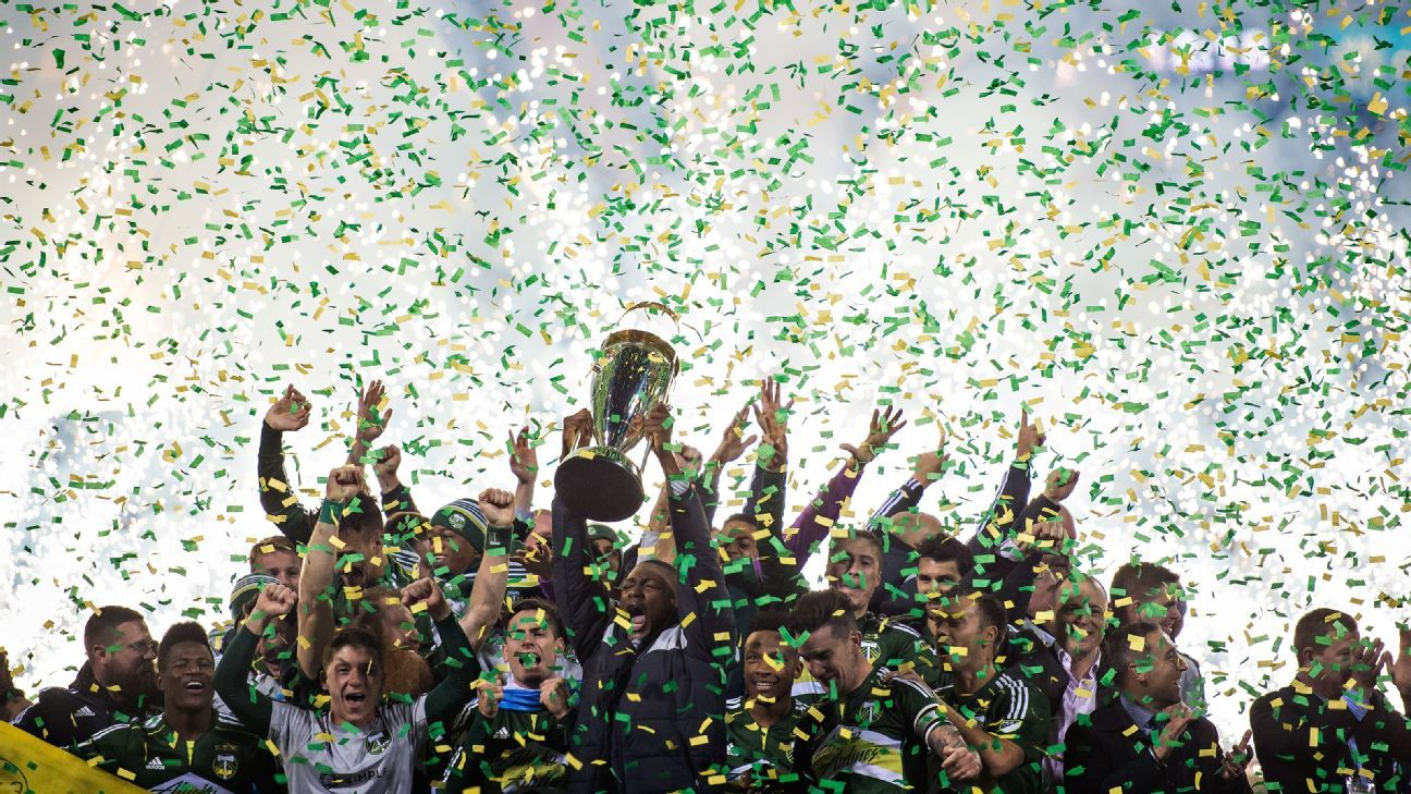 Confetti rains down over the Portland Timbers after winning the MLS Cup on Sunday in Columbus, Ohio. The Timbers defeated the Columbus Crew SC 2-1.