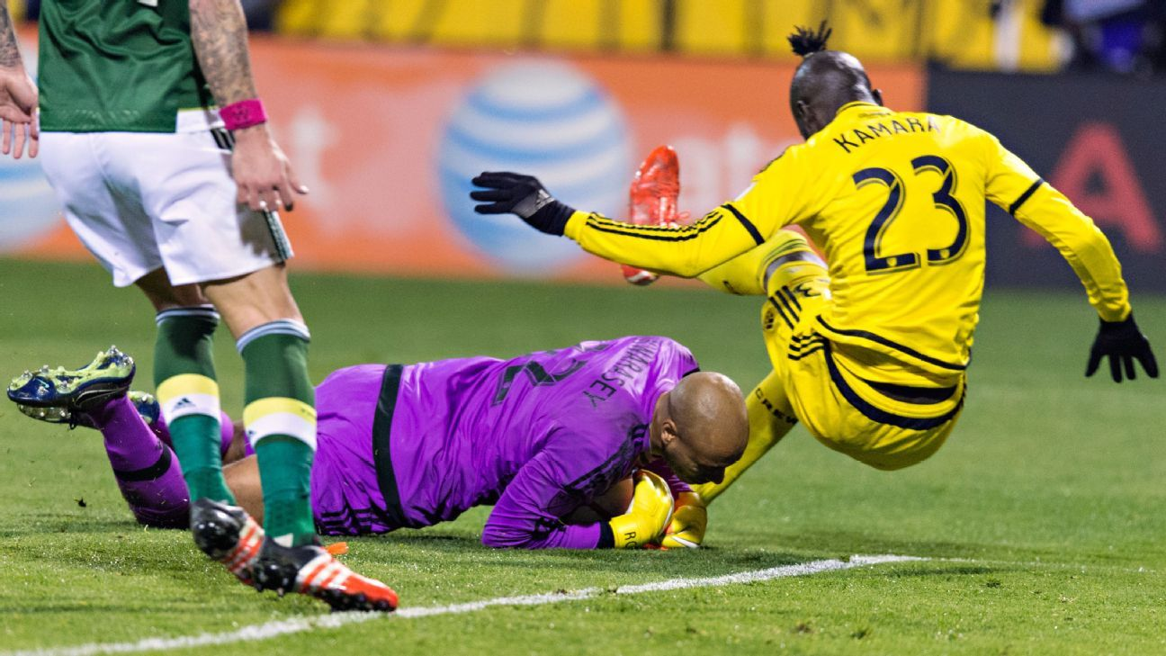 After scoring a goal in the first half, Kamara attempts another goal in the second but Timbers goalkeeper Adam Larsen makes a save.