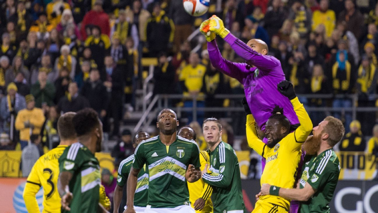 Timbers goalkeeper Adam Larsen Kwarasey punches away a cross late in the second half.
