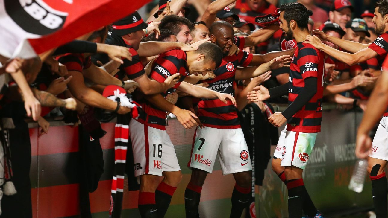 SYDNEY, AUSTRALIA - DECEMBER 12:  Romeo Castelen of the Wanderers celebrates with team mates and fans after scoring their second goal during the round 10 A-League match between the Western Sydney Wanderers and Melbourne Victory at Pirtek Stadium on Decemb